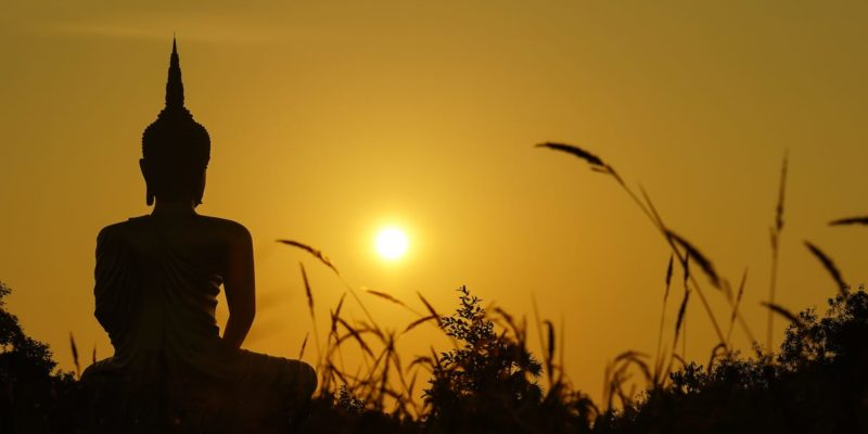 Buddha statue in the sunset